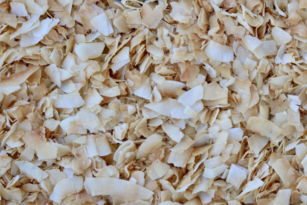Close up, toasted coconut flakes.