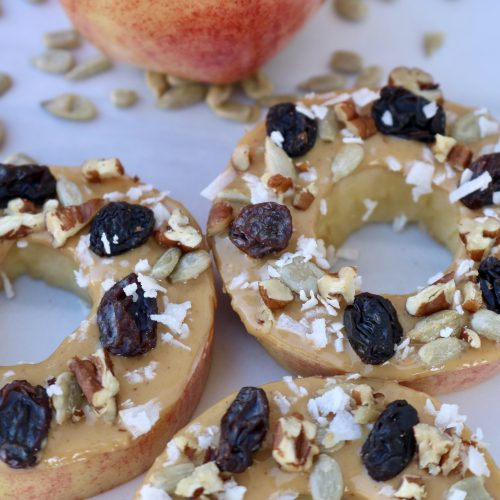 Apple Cookie, sliced apples topped with peanut butter, raisins, sunflower seeds, walnuts and coconut.
