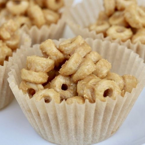 Close up, Peanut Butter Cereal Bites in cupcake liners on a plate.