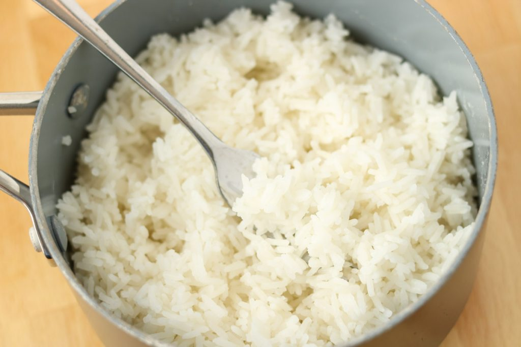 Finished rice fluffed with fork.