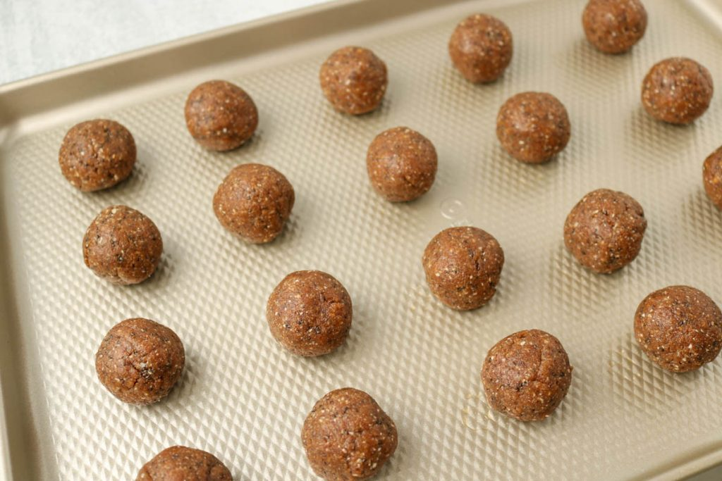 Finished Almond Butter Energy Balls on a sheet tray.