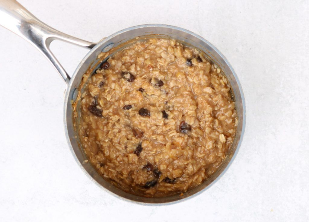 Small pot of finished oatmeal cooked.