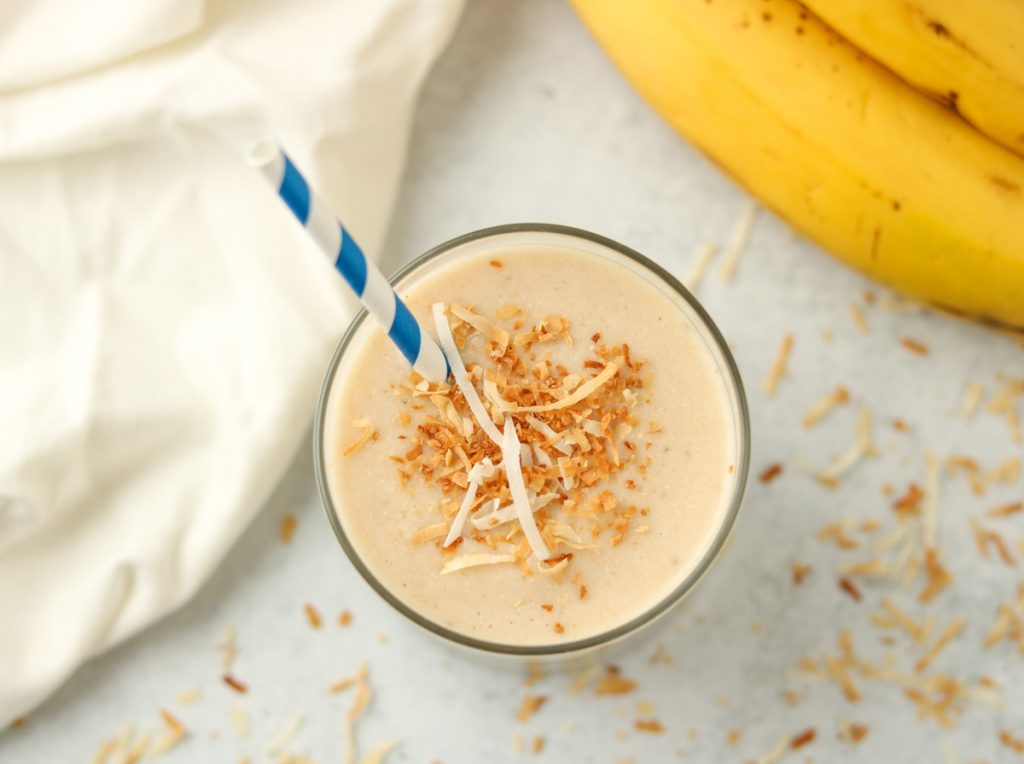 Over head, finished smoothie with toasted coconut on top.