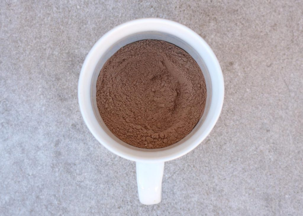 Mug with dry ingredients mixed together.