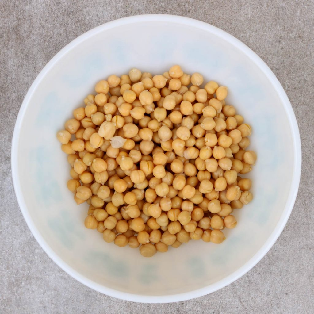 Whole chickpeas in a white bowl.