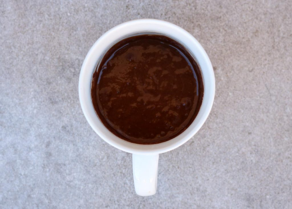 Mug with wet ingredients incorporated into dry.