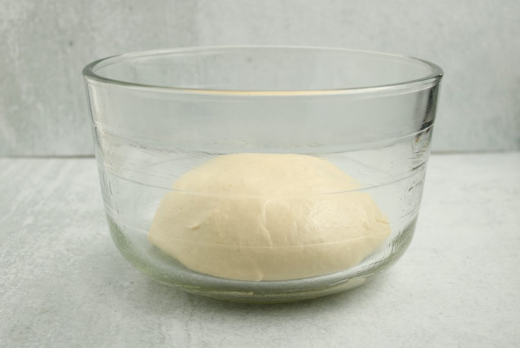 Dough in clear bowl.