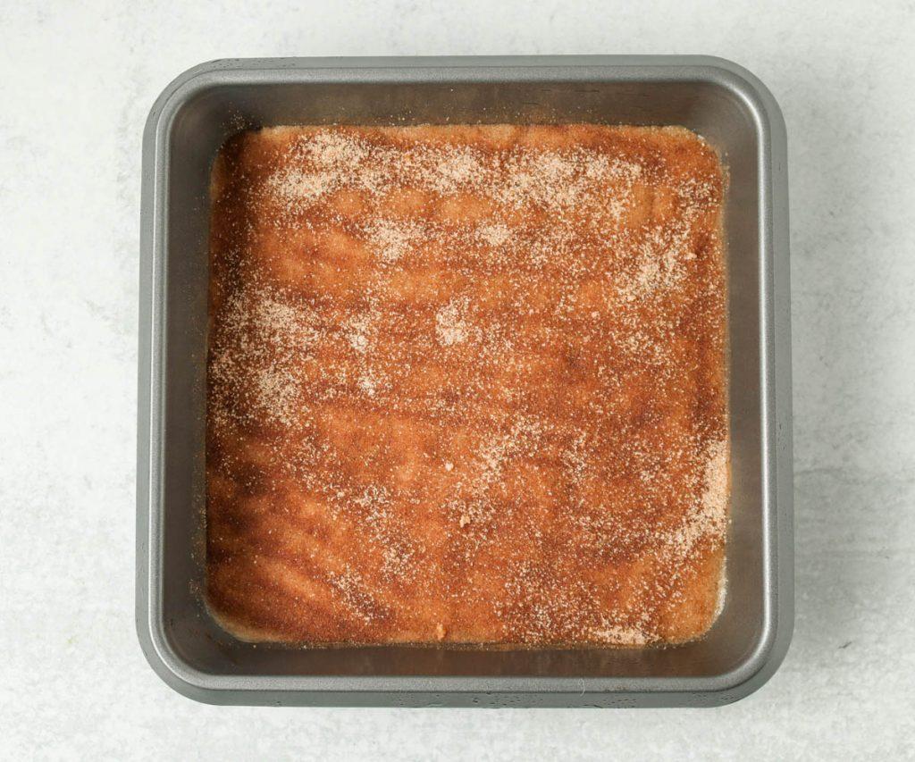 Cinnamon sugar sprinkled on top of dough uncooked.