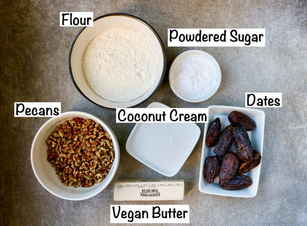 All of the ingredients for your bars in small bowls with labels next to each ingredient.