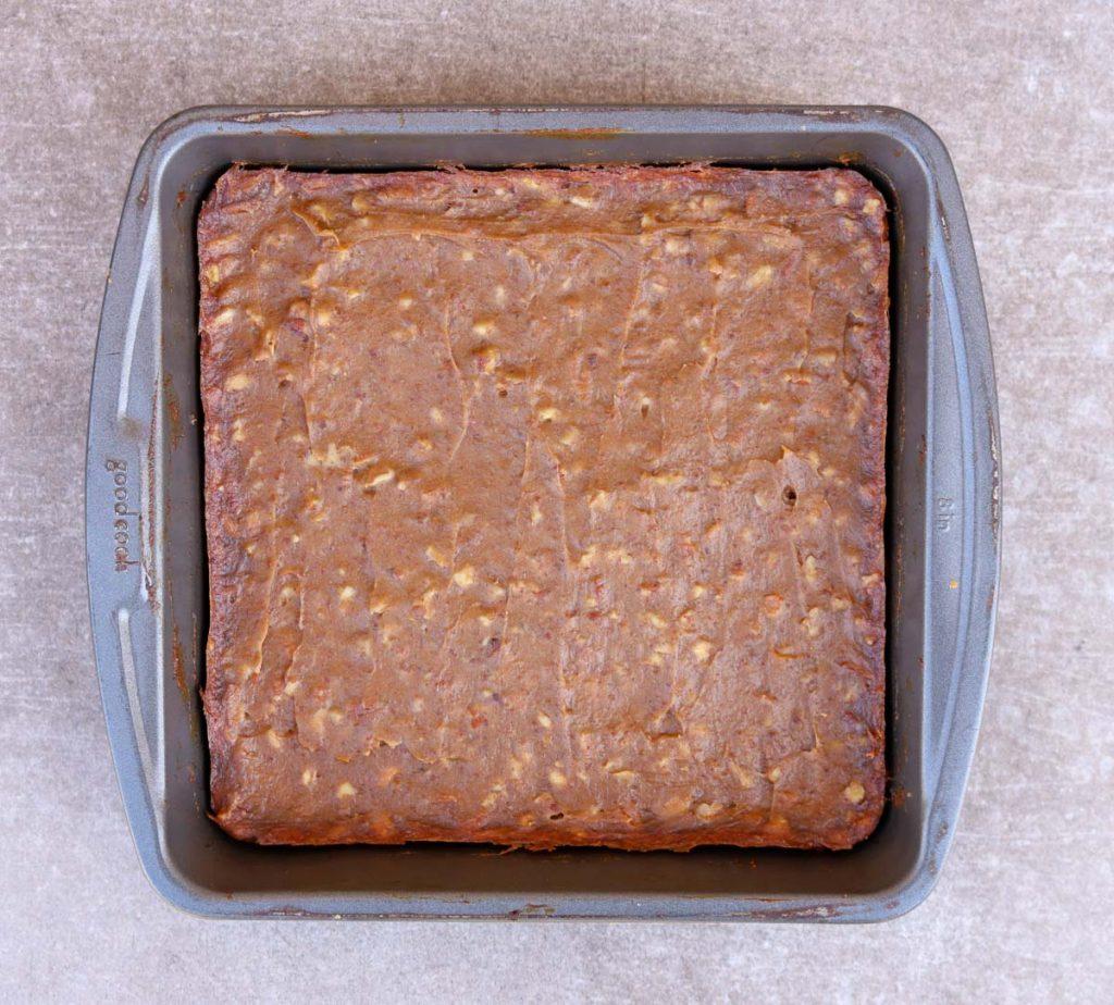 Baked pecan pie bars in the pan.