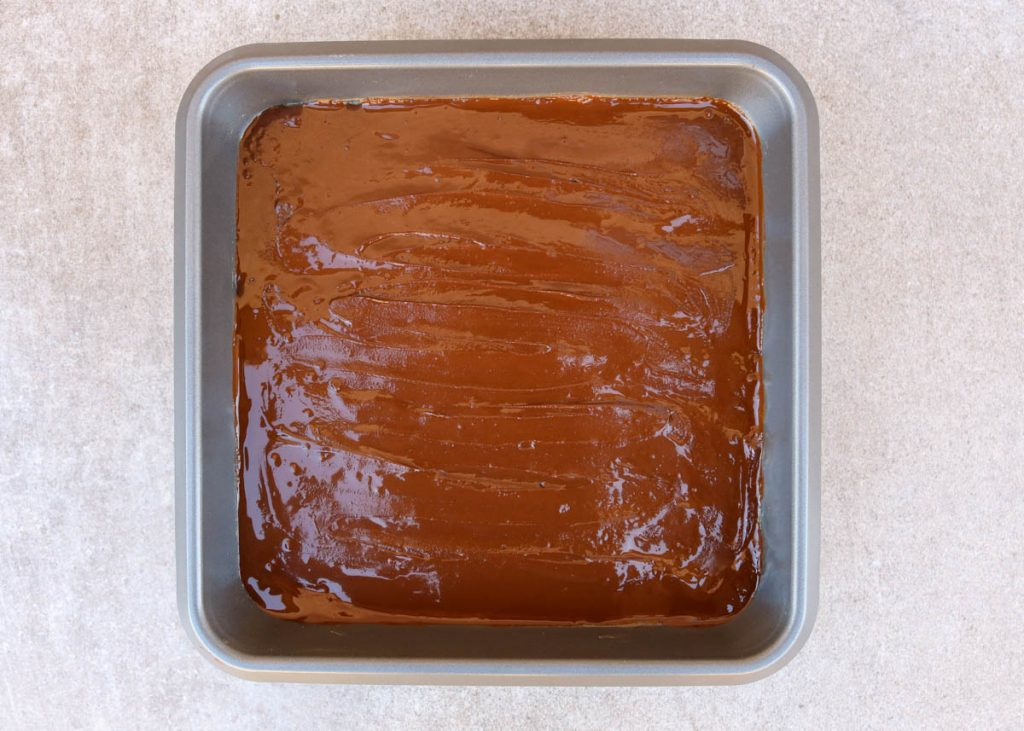 Chocolate layer spread evenly onto coconut and date caramel layer.