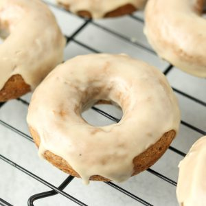 Glazed donuts on a wire rack.