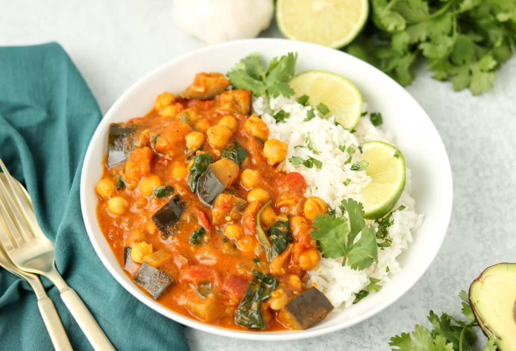 Close up, Curry in a bowl with rice, cilantro and lime.