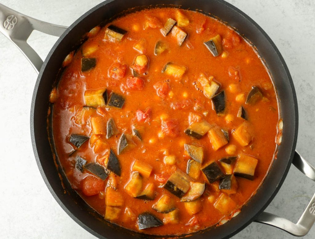 Aubergine now tender and curry has come together in pan.