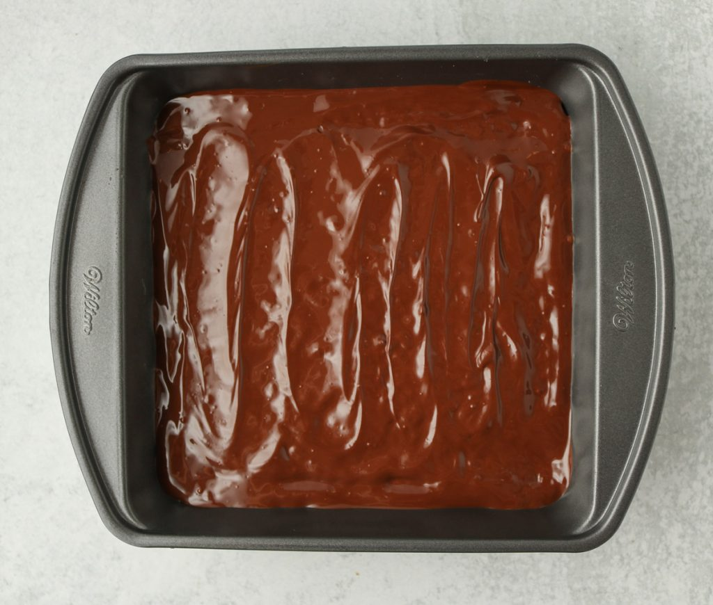 Chocolate evenly spread on top of treats.